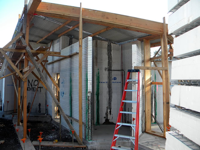 This view is from the rear left of building #3 looking into a bathroom another lower roof will be installed where the ladder is now setting, the height of the wall panels will be the lower roof level.