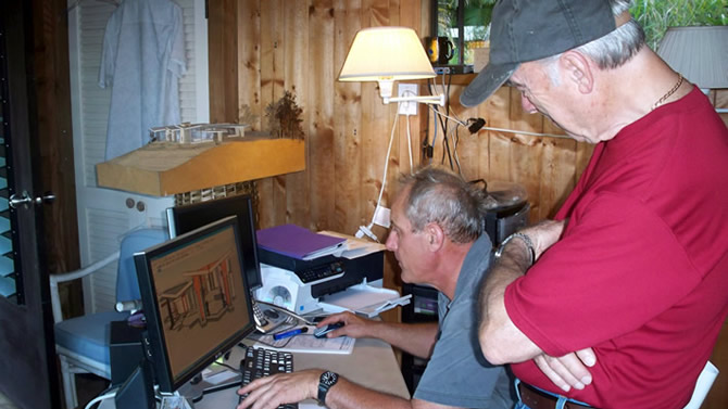 Robert Mechielsen and Ty Drake going over details of the Hi'ilani project in our office located just off site, notice the model just above the computer screen.