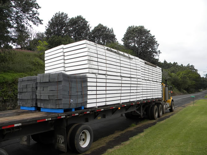 Four-simi truck loads were shipped with approximately 20,000 sq. ft. of Tridipanels and wire mesh accessories, Hilo is approximately 45 miles from the job site, we had much hard rain and the concrete pour was held up. The Tridipanels and wire mesh were unloaded on Waipo Road approximately one half mile below the job site, smaller trucks moved the half mile up to the job site and unloaded.