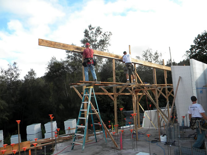 Beau Flack and Rod Hadrian Jr. installing forms at the perimeter of roof #3.
