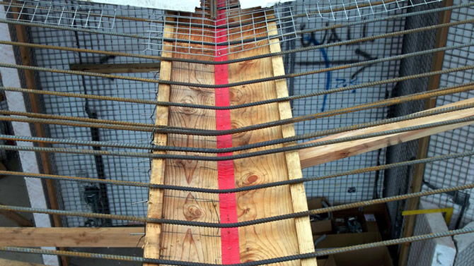 This view shows the form at the valley of the roof, the foam is removed from the Tridipanels, the concrete will be pumped in from the topside, the red duct tape covers the crack between the form lumber.