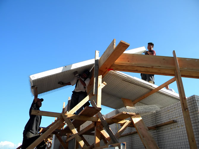 Installing Tridipanel roofs, all of the Tridipanels were installed in one day on roof #3.