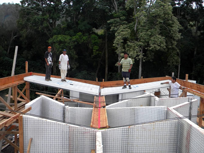 The first Tridipanels installed on the roof, the guys inspecting their work.