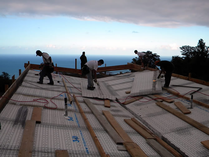 Fastening down the Tridipanel, this roof length is approximately sixty feet long with the last fifteen feet free spanned out with no columns for support.