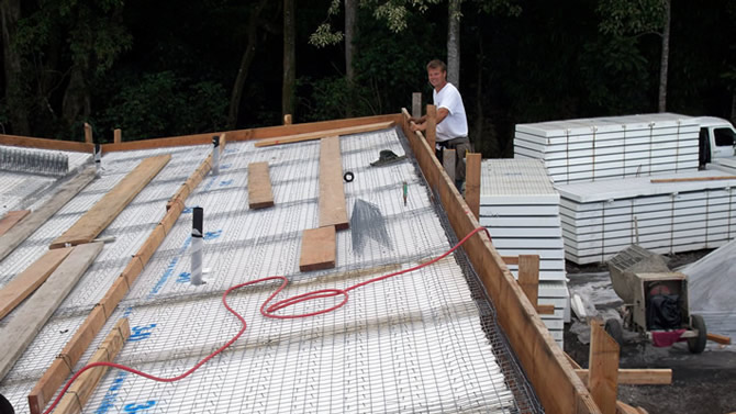 Rod Hadrian Jr. checking out the finished Tridipanel roof.